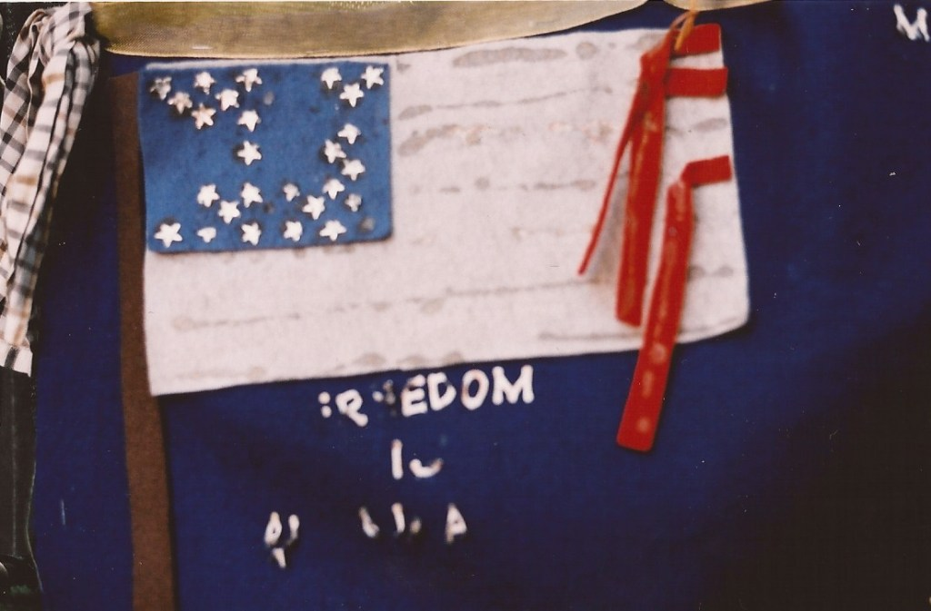 this image was taken one year after the hit on world trade centre a lot of symbols flags decorated ground zero, there was a strong energy there, not of hate or revenge  as I felt it and this home made worn out flag without all the stars not in sorrow but in power and compassion this flag is the flag of a Nation that will what ever happens stand together for freedom